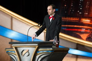 Michael T. Banker on stage at the Wilshire Ebell Theater in Los Angeles to accept his award.
