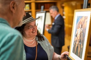 Writer KD Julicher admiring her illustration with instructor David Farland.