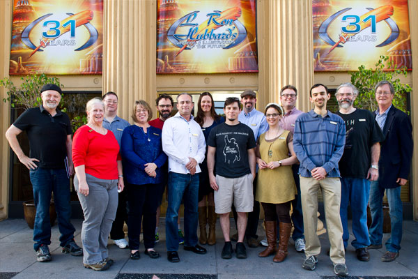 Writer Workshop Instructors David Farland (far left) and Tim Powers (far right) with the writer winners.