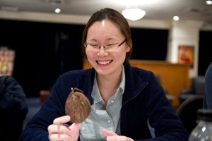 Artist Jessica Chi Lee with her object -- a mini coconut.