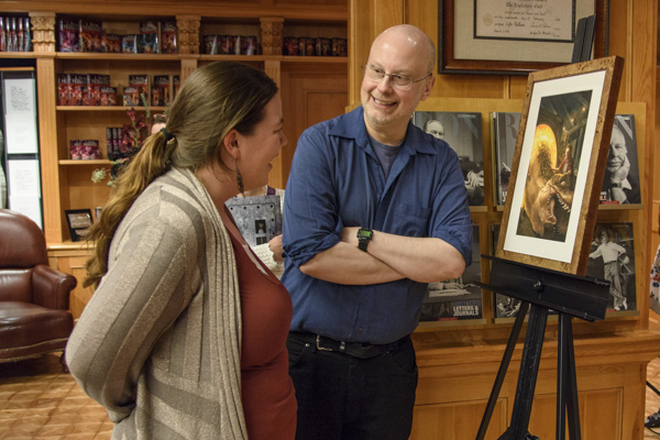 Robert Sawyer talking with Rachael Jones about her story's illustration.