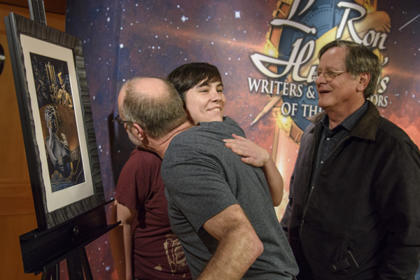 Writer Stephen Merlino was ecstatic over his illustration by Maricela Ugarte Pena as instructor Tim Powers looked on.