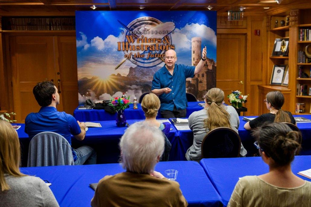 Robert J. Sawyer speaking to writer winners