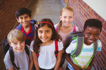 Smiling kids wearing backpacks