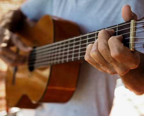 Writing Practice - Writers learn from musicians - Write Your Journey: Musician Nigel Rowles playing guitar