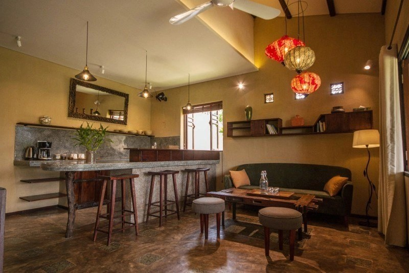Vietnam Writing Retreat - Write Your Journey: An Villa Hoi An, apartment view showing living area and spacious kitchen.