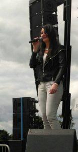 Olivia Douglas of Ferbane singing at Obamafest 2016 - we hope Willie Rimes did not disrupt the show