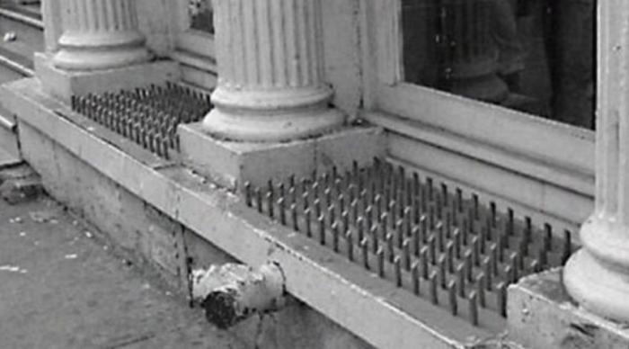 Anti Homeless Spikes in an American Window - many homeless are war veterans from the US Army