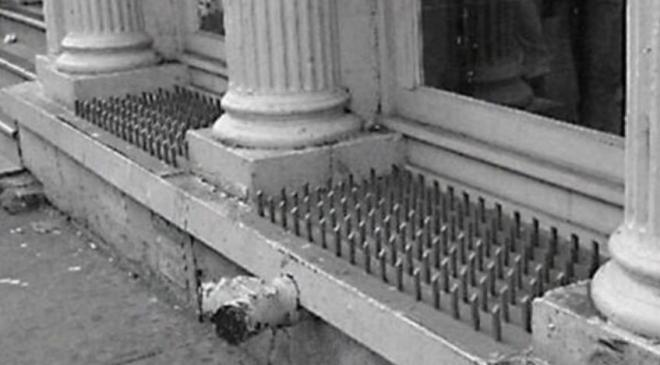 Anti Homeless Spikes in an American Window - many homess are war veterans from the US Army