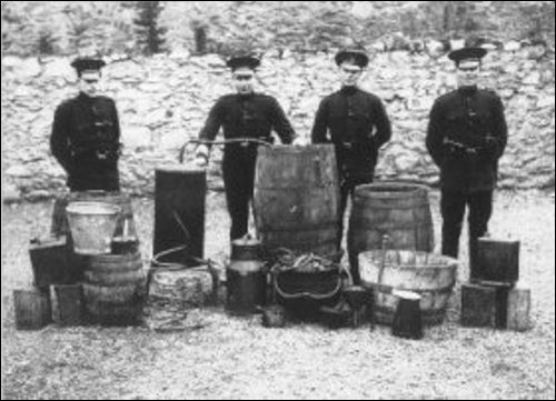 "Police with a siezed still in Inisowen - dad and Willie Carty used to run one in sheds while leaving a ribbish worm and paraphanalia in a field to be ""found"" by customs men, and a few bottles for themselves to keep them quiet!"