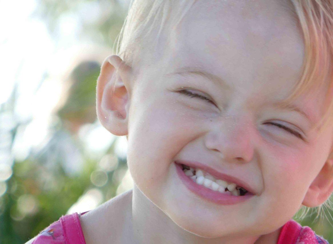 https://www.writteninwaikiki.com/the-art-of-saying-no/ toddler child cheeky grin