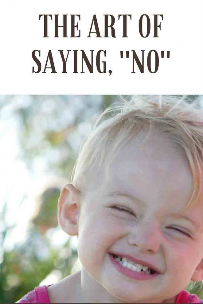 https://www.writteninwaikiki.com/the-art-of-saying-no/ child toddler cheeky grin