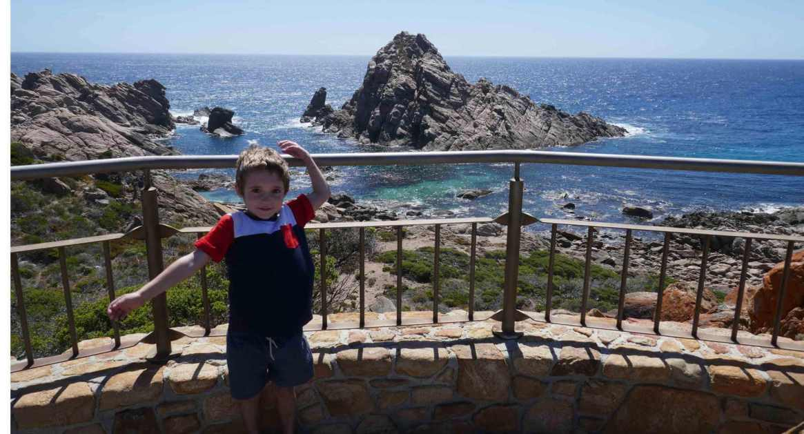 child standing at Sugarloaf Rock Yallingup Western Australia
