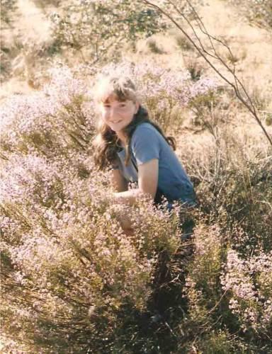 girl sitting in wildflowers