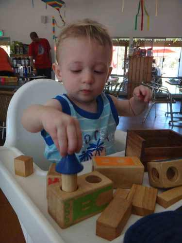 boy toddler playing with blocks