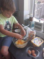Isaac making a cake