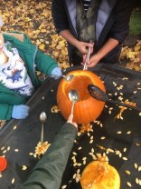 Everyone had a go at scooping out pumpkin seeds.