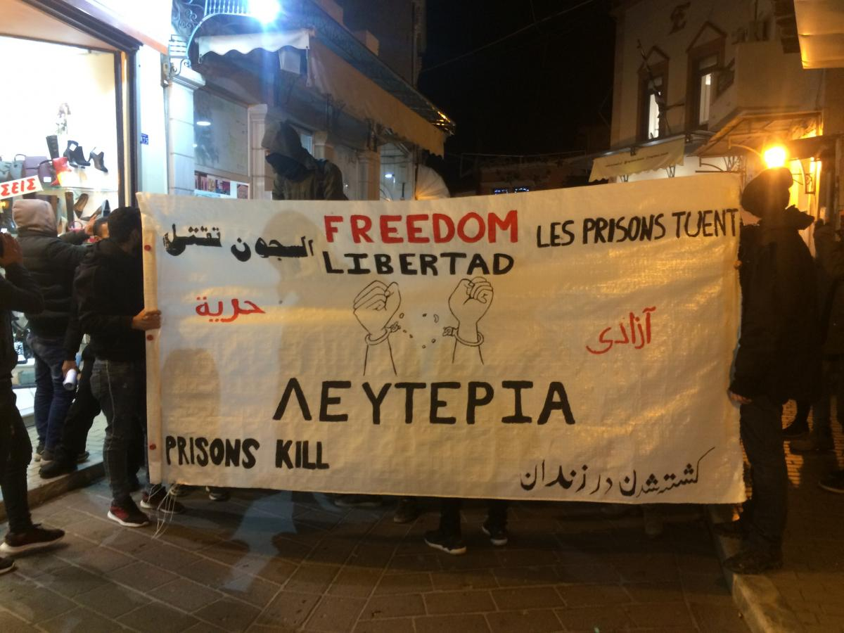 People protest against the Pre-Removal Detention Centre in Moria Camp after an Iranian migrant was found dead, hung in his cell.