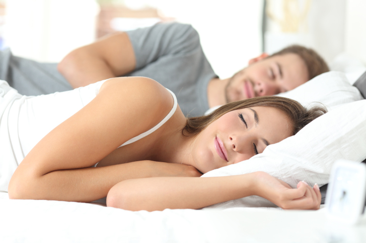 Couple sleeping in a comfortable bed_299239