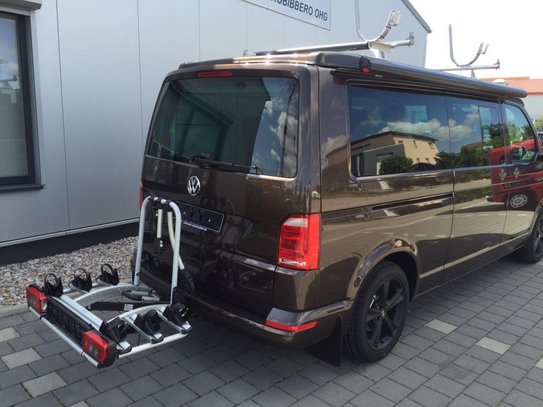 Ausgeliefertes Kundenfahrzeug mit verschiedenen Gepäckträgern - WSR Reisemobil / Camper / Caravan auf Basis des Volkswagen Transporter der 6. Generation