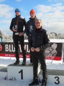 Schirmherr Reinhard Penninger überreicht die Pokale an die Tagessieger Andreas Weishäupl und Silvia Birnböck.