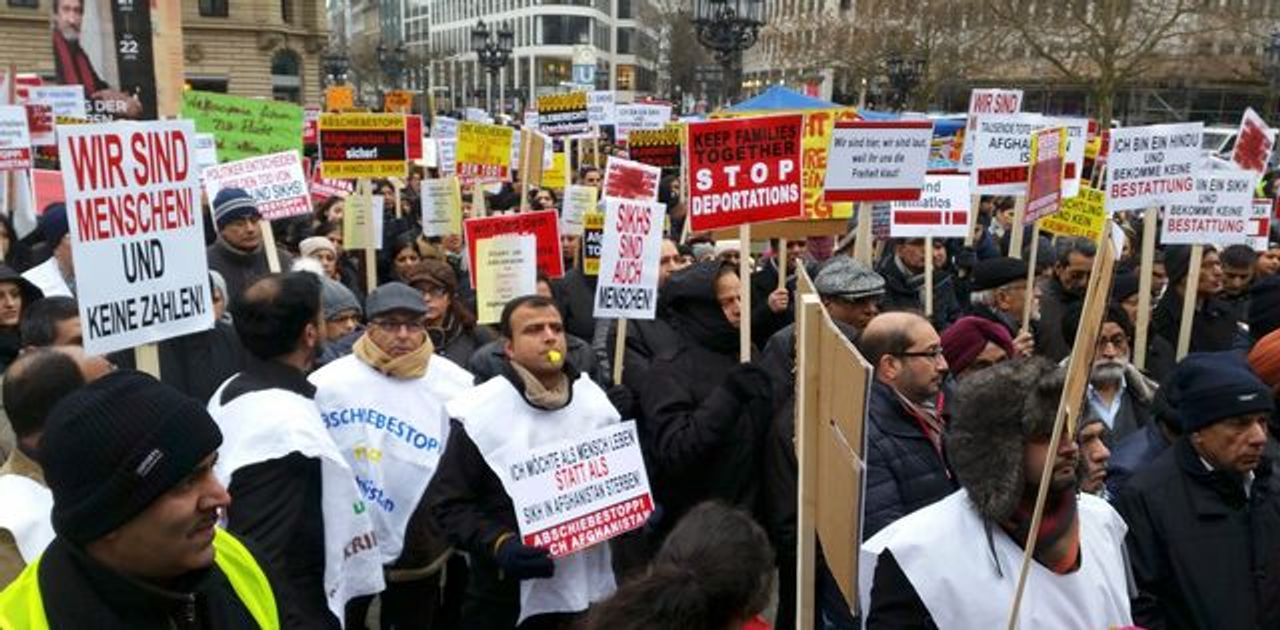 Pro-Afghan refugees rally at the Opernplatz in Frankfurt, Germany