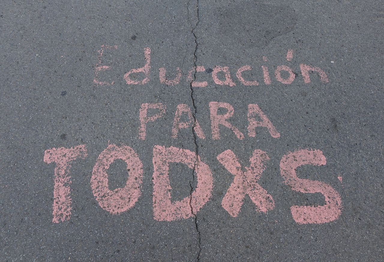'Education for all' painted on the street at UPR