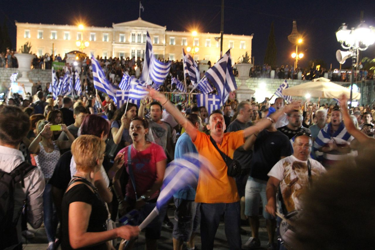 Greek people celebrate victory of No vote in referendum on Syntagma square in Athens