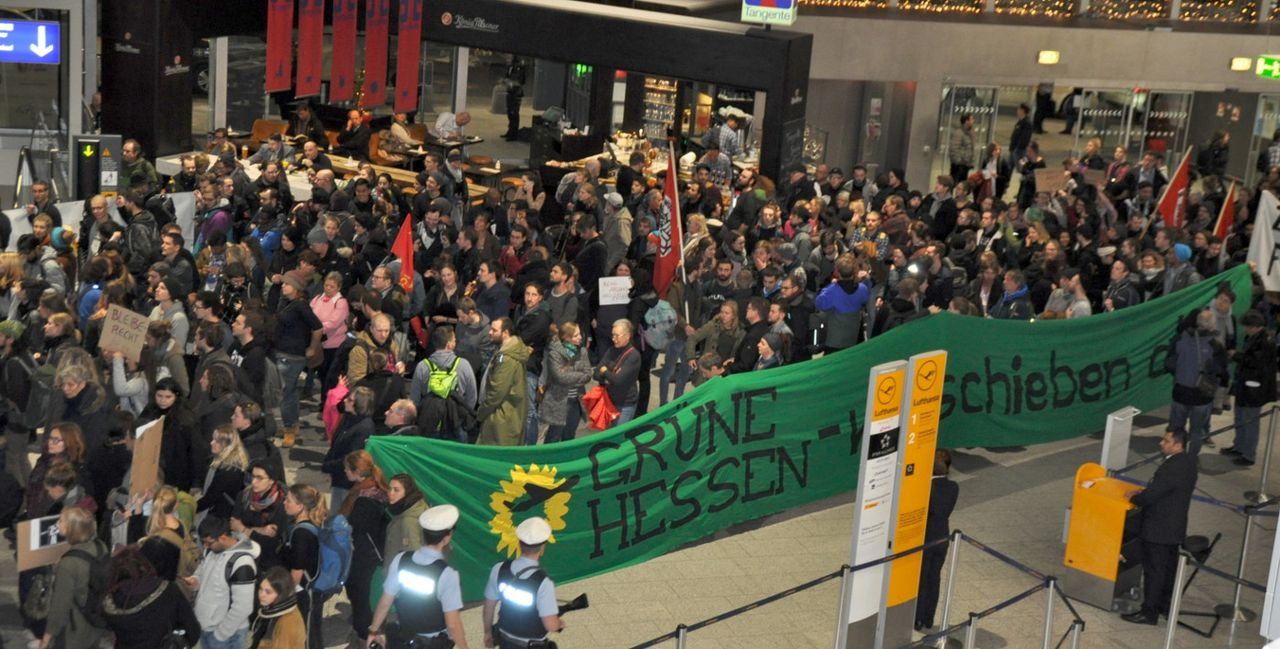 Pro-refugee demonstrators in Frankfurt with-anti Green politicians banner