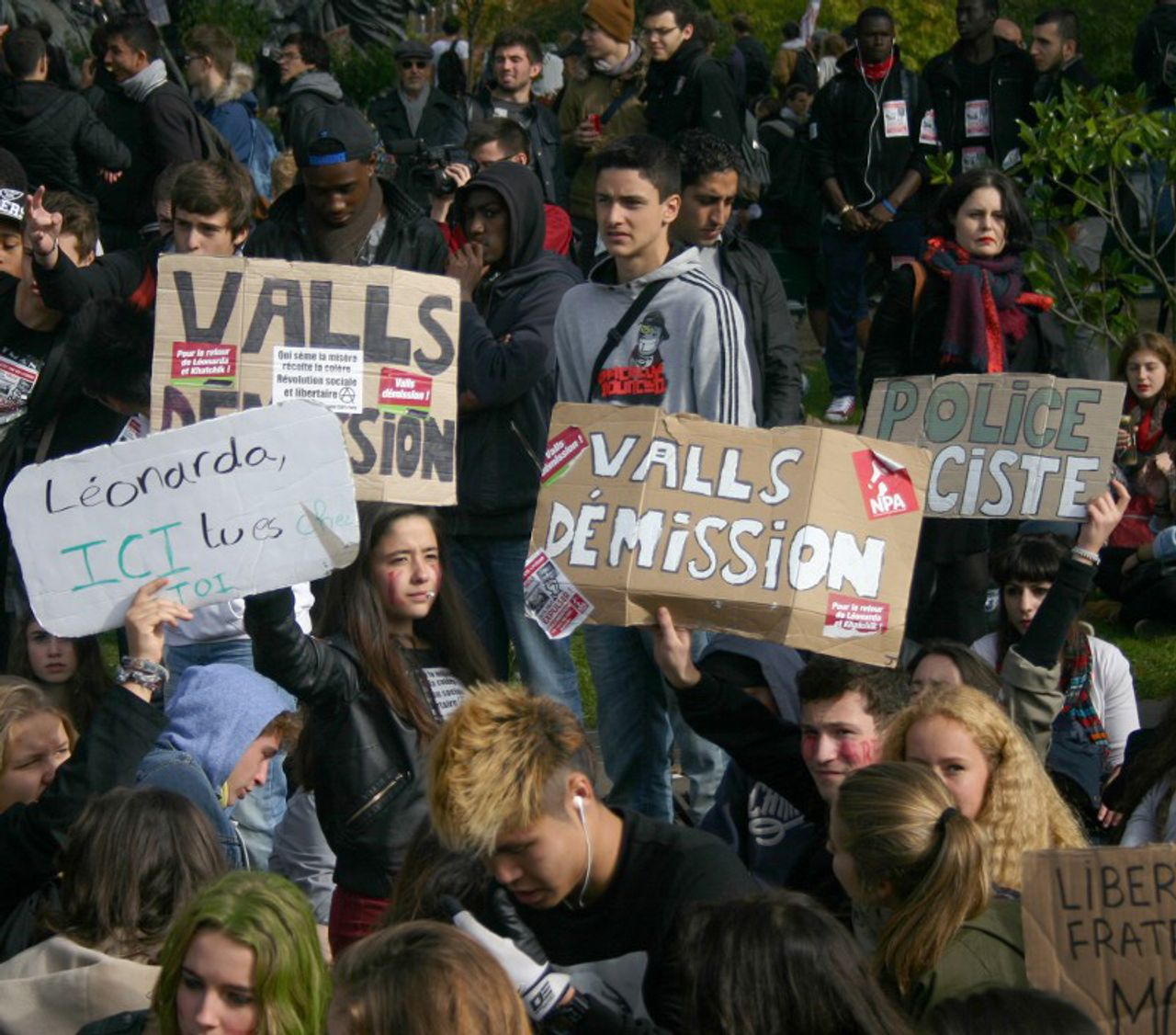 Demonstrating students'placards call for sacking Minister Valls, and say 'Leonarda, you belong here', and 'Liberty, equality, fraternity'