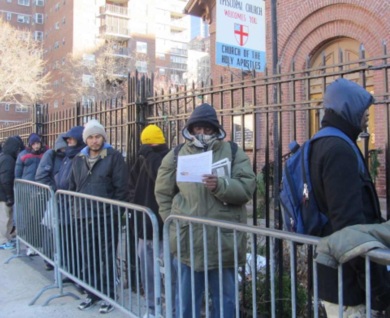 Line up for hot meal at Church of the Holy Apostles in Manhattan