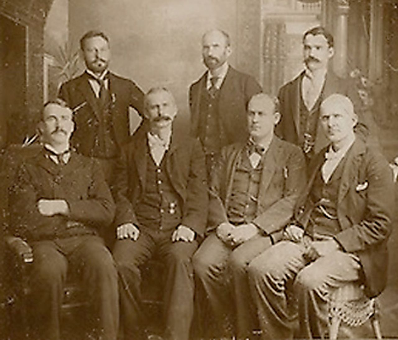 Eugene Debs, seated at the right, and other American Railway Union leaders imprisoned for their role in the Pullman Strike. Debs became a socialist after the experience