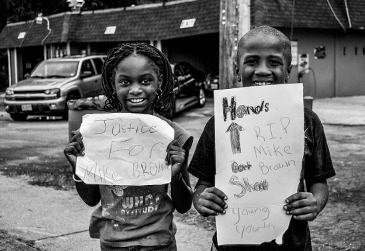 Youth of Ferguson (2014) by Divine Williams, photograph (16 x 20 inches) in the Personal is Political is Personal exhibit at 440 Gallery, Brooklyn NY.