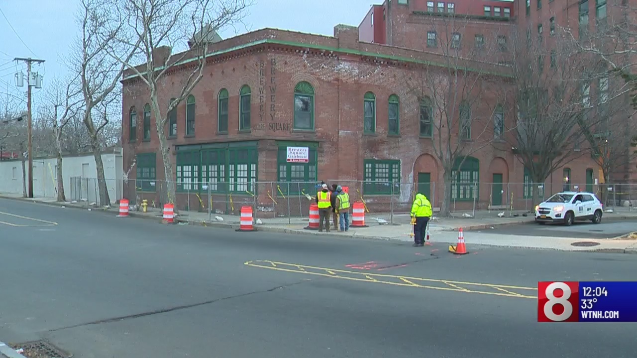 Demolition equipment is set up for a historic building in New Haven despite protests