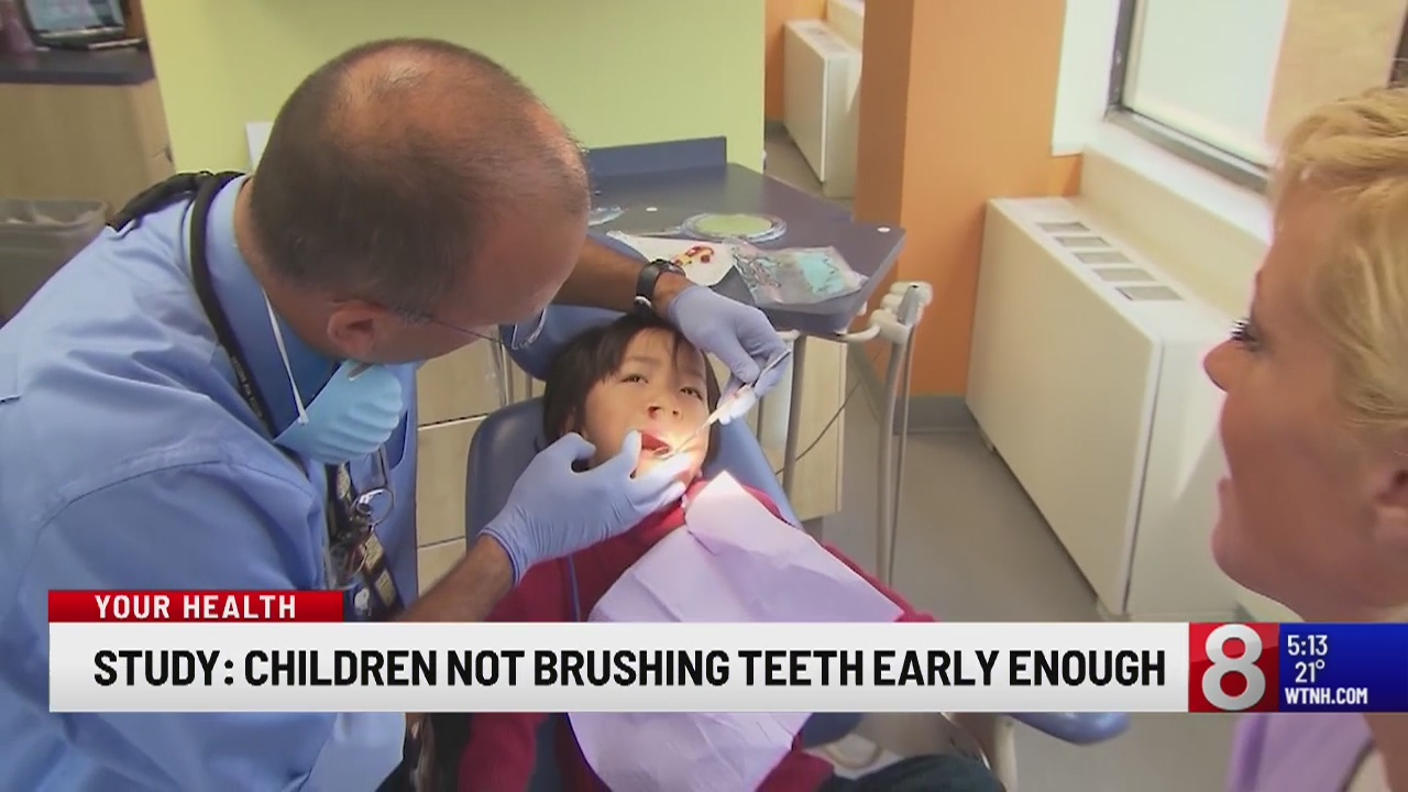 How long should parents wait to brush their child's teeth?