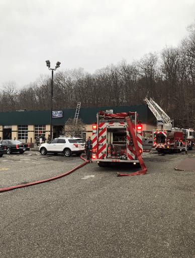 2019-04-02 torrington fire trucks commercial building rightsideup_1554248297160.PNG.jpg