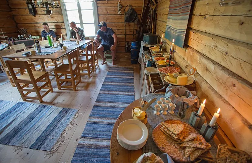 Meals are served inside the main cabin at Guenja