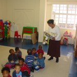 Assistant Teacher Shirley distributing gifts to Grade 0 learners