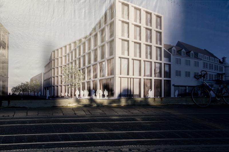 """So soll das Gebäude an der Eichhornstraße aussehen, wenn es fertig ist (Grafik am Bauzau). Man sieht schon in der Entwurfsansicht recht gut, dass das Haus ein wenig """"zu hoch"""" geraten ist."""