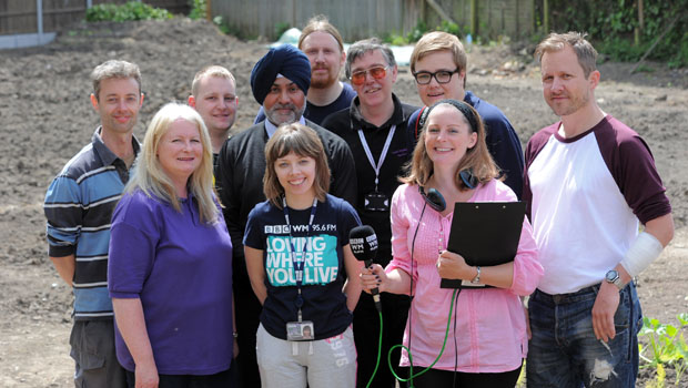 Volunteers and the BBC WM in the garden.