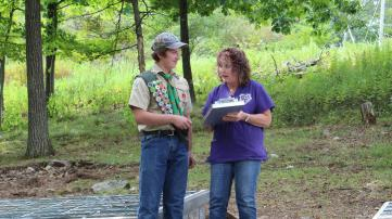 Hunter Endrikat (left), of Boy Scout Troop 477, is pictured with Suzyn Barron, President of the Humane Society, at the 'Resting Paws Pet Cemetery.' Photo provided.