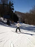 Amy Goodwin in skis on a snow covered hill
