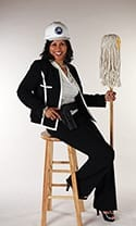 Diane Lewis sitting on a stool holding a mop