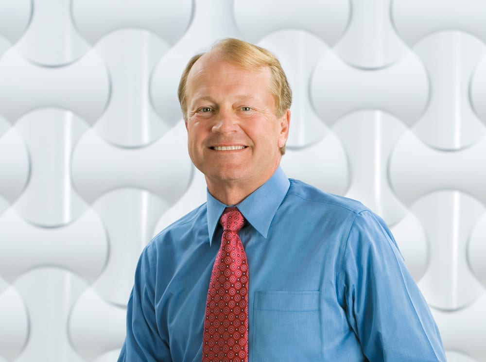 John Chambers smiling for the camera.