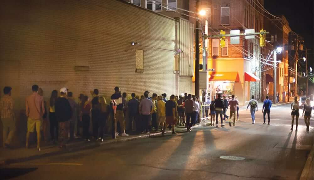 College students in line for a club in downtown Morgantown.
