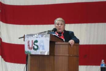 Anne Montague making a speech at a podium