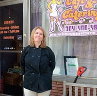 Jennifer Pettigrew Burns standing in front of Ms. Groovy's Catering