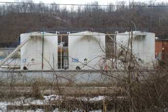 view of water tanks behind dead plants