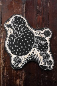 Piece of art showing a poodle.