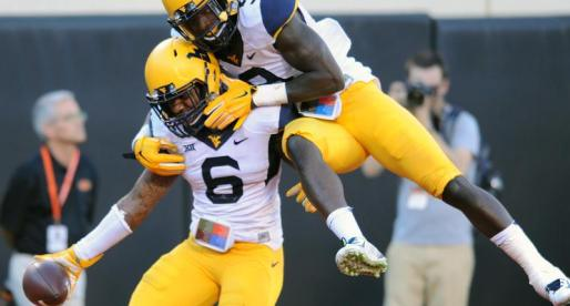Mountaineers outmatch Cowboys, 34-10
